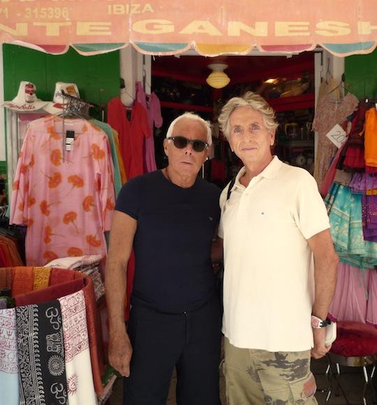 Carlos y Giorgio Armani
