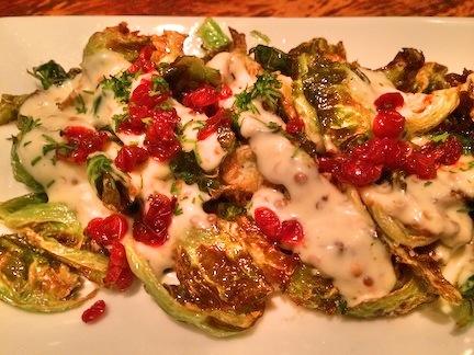 CRISPY BRUSSELS AFELIA: Brussels sprouts, coriander seed, barberries, garlic yogurt
